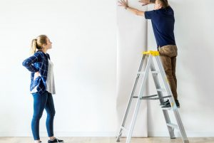 Image showing couple wallpapering their home