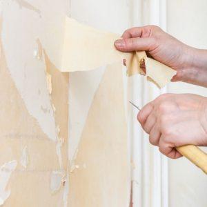 remove wallpaper with a scraper